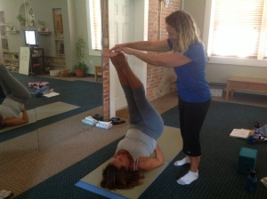 Assisting Linda with Ardha Sarvangasana (half shoulder stand)