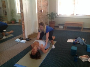 Helping Linda achieve a deeper stretch in Matsyasana (fish pose)